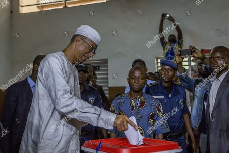 Benin Presidential Candidate Lionel Zinsou (l) Casts His Ballot in the Benin Presidential Elections in Cotonou Benin 06 March 2016 About 4 6 Million Voters Will Have the Choice Between a Record 33 Presidential Candidates the Front-runner is Prime Minister Lionel Zinsou 61 Though Some Voters May Hold His French Connections Against Him Other Top Candidates Include Cotton Magnate Patrice Talon Regarded by Many As Benin's Richest Man; Businessman Sebastien Alavon who Made His Fortune in the Food Industry; Former Premier Pascal Koupaki; and Abdoulaye Bio Tchane a Former Africa Director of the International Monetary Fund the Race was Expected to Be One of the Tightest Ever in Benin Which is Regarded As One of Africa's Most Solid Democracies Benin Cotonou