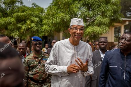 Benin Presidential Candidate Lionel Zinsou (c) Walks After Casting His Ballot in the Benin Presidential Elections in Cotonou Benin 06 March 2016 About 4 6 Million Voters Will Have the Choice Between a Record 33 Presidential Candidates the Front-runner is Prime Minister Lionel Zinsou 61 Though Some Voters May Hold His French Connections Against Him Other Top Candidates Include Cotton Magnate Patrice Talon Regarded by Many As Benin's Richest Man; Businessman Sebastien Alavon who Made His Fortune in the Food Industry; Former Premier Pascal Koupaki; and Abdoulaye Bio Tchane a Former Africa Director of the International Monetary Fund the Race was Expected to Be One of the Tightest Ever in Benin Which is Regarded As One of Africa's Most Solid Democracies Benin Cotonou