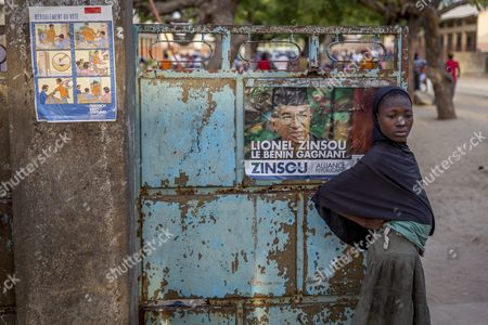 A Photograph Made Available 03 March 2016 Shows a Girl From Benin Standing Besides an Election Campaign Poster of Lionel Zinsou in Cotonou Benin 02 March 2016 Zinsou Franco-beninian is the Candidate of Current President Boni Yayi who Can't Run For a Third Term in Office on the Left There is a Placcard Explaining How to Vote in Pictures Presidential Elections in Benin Take Place on 06 March 2016 Benin Cotonou