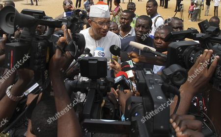 Presidential Candidate Lionel Zinsou Talks to Media After Casting His Ballot in the Benin Presidential Elections in Cotonou Benin 06 March 2016 About 4 6 Million Voters Will Have the Choice Between a Record 33 Presidential Candidates the Front-runner is Prime Minister Lionel Zinsou 61 Though Some Voters May Hold His French Connections Against Him Other Top Candidates Include Cotton Magnate Patrice Talon Regarded by Many As Benin's Richest Man; Businessman Sebastien Alavon who Made His Fortune in the Food Industry; Former Premier Pascal Koupaki; and Abdoulaye Bio Tchane a Former Africa Director of the International Monetary Fund the Race was Expected to Be One of the Tightest Ever in Benin Which is Regarded As One of Africa's Most Solid Democracies Benin Cotonou