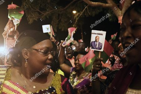 Stock Image of Supporters of Roch Marc Christian Kabore (not Pictured) the Presidential Candidate For the People's Movement For Progress (mpp) Celebrate His Victory in the General Elections in Ouagadougou Burkina Faso 01 December 2015 This is the First Election in Burkina Faso After President Blaise Compaore was Forced From Office Last Year Which Sparked a Year of Political Uncertainty Burkina Faso Ouagadougou