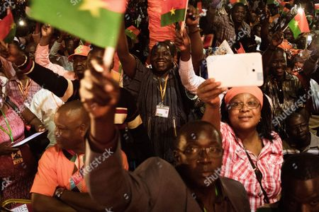 Stock Image of Supporters of Roch Marc Christian Kabore (not Pictured) the Presidential Candidate For the Mpp (mouvement Pour Le Peuple Et Le Progr?s) Celebrate His Victory in the General Elections in Ouagadougou Burkina Faso 01 December 2015 This is the First Election in Burkina Faso After President Blaise Compaore was Forced From Office Last Year Which Sparked a Year of Political Uncertainty Burkina Faso Ouagadougou