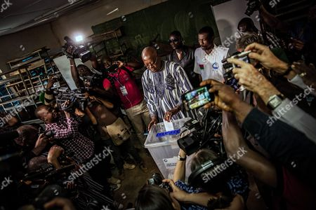 Roch Marc Christian Kabore (c) the Presidential Candidate For the Mpp (mouvement Pour Le Peuple Et Le Progr?s) Casts His Ballot in the General Elections in Ouagadougou Burkina Faso 29 November 2015 Polls Opened in Burkina Faso's Presidential and Parliamentary Election on 29 November with Expectations High One Year After a Violent Public Uprising Forced the Long-time President out of Office It is the First Election in the Country After President Blaise Compaore was Forced From Office Last Year Which Sparked a Year of Political Uncertainty Thousands Are Expected to Vote to Elect a New President and Parliament with Roch Marc Christian Kabore and Zephirin Diabre Seen As Strongest Contenders For President Burkina Faso Ouagadougou