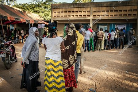 Burkinabe People Line Up at a Polling Station to Cast Their Ballots in the General Elections in Ouagadougou Burkina Faso 29 November 2015 Polls Opened in Burkina Faso's Presidential and Parliamentary Election on 29 November with Expectations High One Year After a Violent Public Uprising Forced the Long-time President out of Office It is the First Election in the Country After President Blaise Compaore was Forced From Office Last Year Which Sparked a Year of Political Uncertainty Thousands Are Expected to Vote to Elect a New President and Parliament with Roch Marc Christian Kabore and Zephirin Diabre Seen As Strongest Contenders For President Burkina Faso Ouagadougou