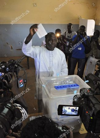 Zephirin Diabre the Presidental Candidate For the Upc ( L'union Pour Le Progr?s Et Le Changement) Casts His Ballot in the General Elections in Ouagadougou Burkina Faso 29 November 2015 Polls Opened in Burkina Faso's Presidential and Parliamentary Election on 29 November with Expectations High One Year After a Violent Public Uprising Forced the Long-time President out of Office It is the First Election in the Country After President Blaise Compaore was Forced From Office Last Year Which Sparked a Year of Political Uncertainty Thousands Are Expected to Vote to Elect a New President and Parliament with Roch Marc Christian Kabore and Zephirin Diabre Seen As Strongest Contenders For President Burkina Faso Ouagadougou