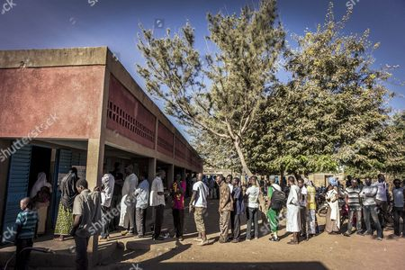 Stock Picture of Burkinabe People Line Up at a Polling Station to Cast Their Ballots in the General Elections in Ouagadougou Burkina Faso 29 November 2015 Polls Opened in Burkina Faso's Presidential and Parliamentary Election on 29 November with Expectations High One Year After a Violent Public Uprising Forced the Long-time President out of Office It is the First Election in the Country After President Blaise Compaore was Forced From Office Last Year Which Sparked a Year of Political Uncertainty Thousands Are Expected to Vote to Elect a New President and Parliament with Roch Marc Christian Kabore and Zephirin Diabre Seen As Strongest Contenders For President Burkina Faso Ouagadougou