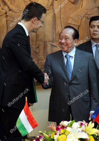 Hungarian Minister of Foreign Minister Peter Szijjarto (l) Shakes Hands with Cambodian Foreign Minister Hor Namhong During a Meeting at the Ministry of Foreign Affairs and International Cooperation in Phnom Penh Cambodia 14 January 2016 Szijjarto is on an Official Visit to Cambodia to Tighten Ties and Cooperation Between the Two Countries Cambodia Phnom Penh