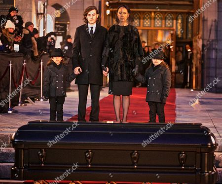 Stock Image of Canadian Singer Celine Dion and Her Sons Rene Charles (2nd L) and the Twins Nelson and Eddy Stand in Front of the Coffin of Their Late Husband and Father Rene Angelil Outside of the Notre Dame Basilica in Montreal Canada 22 January 2016 Canada Montreal