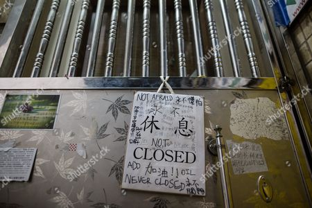 A 'Closed' Sign and Support Messages Hang on the Door of the Causeway Bay Books Store in Hong Kong China 05 February 2016 Guangdong Police Have Finally Confirmed That Booksellers Lam Wing-kee Cheung Chi-ping and Lui Por Are Being Investigated in Mainland China the Three Plus Gui Minhai and Lee Po Also Held by Chinese Police Are Associated with the Publishing House 'Mighty Current' and Causeway Bay Books That Publish and Sell Books Critical of Mainland China Leaders and the Chinese Communist Party China Hong Kong