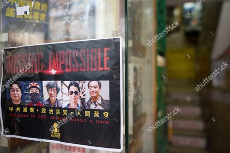A Flyer That Reads 'Missing: Impossible' with the Photos of 5 Missing Booksellers Hangs on the Entrance to Causeway Bay Books Store in Hong Kong China 05 February 2016 Guangdong Police Have Finally Confirmed That Booksellers Lam Wing-kee Cheung Chi-ping and Lui Por Are Being Investigated in Mainland China the Three Plus Gui Minhai and Lee Po Also Held by Chinese Police Are Associated with the Publishing House 'Mighty Current' and Causeway Bay Books That Publish and Sell Books Critical of Mainland China Leaders and the Chinese Communist Party China Hong Kong