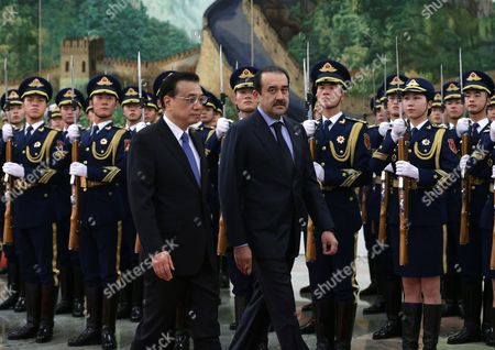 Kazakhstan's Prime Minister Karim Massimov (c-r) and Chinese Premier Li Keqiang (c-l) Review Honour Guards During a Welcoming Ceremony at the Great Hall of the People in Beijing China 14 December 2015 Massimov is on an Official Visit to China to Attend the Shanghai Cooperation Organization Prime Ministers' Meeting China Beijing