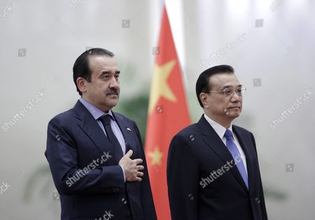 Kazakhstan's Prime Minister Karim Massimov (l) and Chinese Premier Li Keqiang (r) Review Honour Guards During a Welcoming Ceremony at the Great Hall of the People in Beijing China 14 December 2015 Massimov is on an Official Visit to China to Attend the Shanghai Cooperation Organization Prime Ministers' Meeting China Beijing