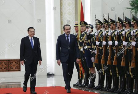 Kazakhstan's Prime Minister Karim Massimov (c) and Chinese Premier Li Keqiang (l) Review Honour Guards During a Welcoming Ceremony at the Great Hall of the People in Beijing China 14 December 2015 Massimov is on an Official Visit to China to Attend the Shanghai Cooperation Organization Prime Ministers' Meeting China Beijing
