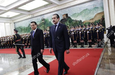Kazakhstan's Prime Minister Karim Massimov (r) and Chinese Premier Li Keqiang Review Honour Guards During a Welcoming Ceremony at the Great Hall of the People in Beijing China 14 December 2015 Massimov is on an Official Visit to China to Attend the Shanghai Cooperation Organization Prime Ministers' Meeting China Beijing