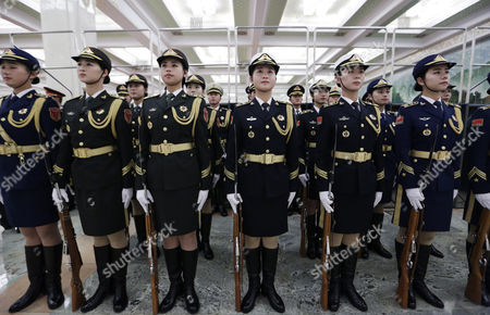 Chinese Female Honour Guards Are Stand at Attention During a Welcome Ceremony For Kazakhstan's Prime Minister Karim Massimov (not Pictured) and Chinese Premier Li Keqiang Review Honour Guards During a Welcoming Ceremony at the Great Hall of the People in Beijing China 14 December 2015 China Beijing