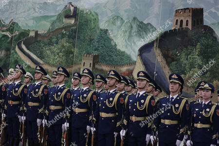 Chinese Honour Guards Stand at Attention During a Welcome Ceremony For Kazakhstan's Prime Minister Karim Massimov (not Pictured) and Chinese Premier Li Keqiang Review Honour Guards During a Welcoming Ceremony at the Great Hall of the People in Beijing China 14 December 2015 China Beijing