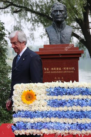 Stock Picture of Uruguayan President Tabare Vazquez Attends a Flower Offering Ceremony to the Bust of Jose Gervasio Artigas by Chinese Artist Yuan Xikun at Chaoyang Park in Beijing China 13 October 2016 the Uruguayan Leader is on an Official Visit to China to Boost Bilateral Ties From 12 to 20 October 2016 China Beijing