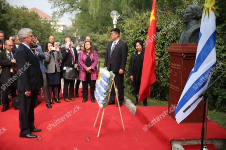 Uruguayan President Tabare Vazquez Attends a Flower Offering Ceremony to the Bust of Jose Gervasio Artigas by Chinese Artist Yuan Xikun at Chaoyang Park in Beijing China 13 October 2016 the Uruguayan Leader is on an Official Visit to China to Boost Bilateral Ties From 12 to 20 October 2016 China Beijing