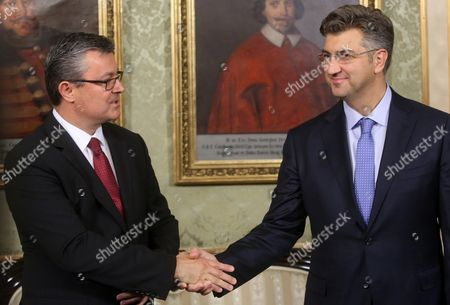 Former Croatian Prime Minister Tihomir Oreskovic (l) Hands Over Authority to New Prime Minister Andrej Plenkovic (r) After Croatian Parliament Has Established a New Government and Prime Minister in Zagreb Croatia 19 October 2016 Croatia Zagreb