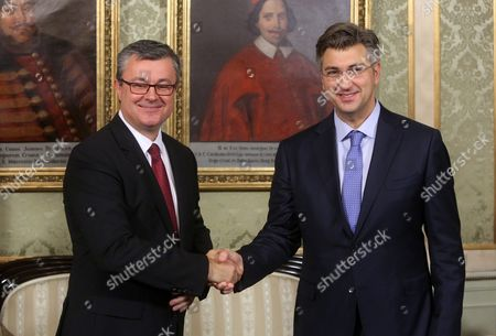 Stock Picture of Former Croatian Prime Minister Tihomir Oreskovic (l) Hands Over Authority to New Prime Minister Andrej Plenkovic (r) After Croatian Parliament Has Established a New Government and Prime Minister in Zagreb Croatia 19 October 2016 Croatia Zagreb