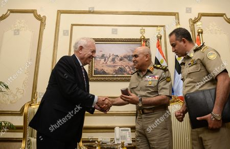 Spanish Foreign Minister Jose Manuel Garcia-margallo (l) Shakes Hands with the Egyptian Minster of Defense Sedki Sobhi (c) at the Ministry of Defense in Cairo Egypt 23 October 2016 Garcia-margallo is on Official Visit to Egypt For Two Days Egypt Cairo