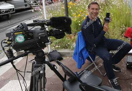 Stock Image of Former Rider and Commentator Jens Voigt at the Finnish Line of Stage 5 of the 102nd Tour De France 2015 Cycling Race Amiens France 08 July 2015 Voigt is Commentating For the Us Network Nbc France Amiens
