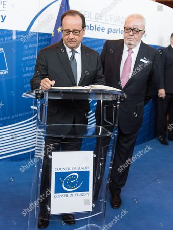 French President Francois Hollande (l) Writes in the Golden Book with President of the Council of Europe (pace) Pedro Agramunt (r) in the Council of Europe in Strasbourg France 11 October 2016 Media Reports on 11 October 2016 State That Russian President Vladimir Putin May Cancel His Planned Meeting with the French President During a Visit to France on 19 October 2016 Following Un Security Council Bid to End to the Bombing of Aleppo France Strasbourg