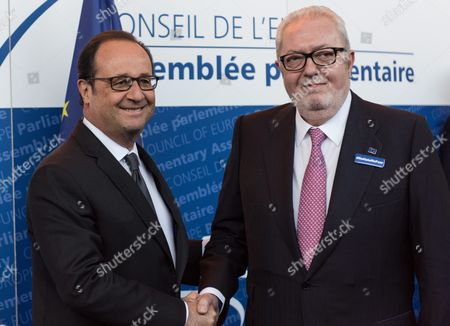 French President Francois Hollande (l) Handshakes President of the Council of Europe (pace) Pedro Agramunt (r) in the Council of Europe in Strasbourg France 11 October 2016 Media Reports on 11 October 2016 State That Russian President Vladimir Putin May Cancel His Planned Meeting with the French President During a Visit to France on 19 October 2016 Following Un Security Council Bid to End to the Bombing of Aleppo France Strasbourg