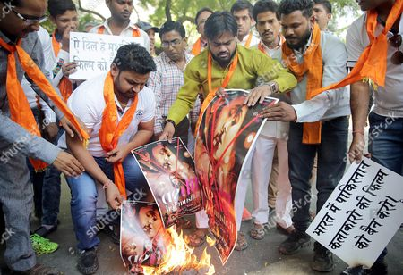 Stock Photo of Indian Activists From the Right-wing Organization Hindu Sena Burn the Posters of Hindi Bollywood Film Ae Dil Hai Mushkil (this Heart is Complicated) During a Protest in New Delhi India 24 October 2016 Members of the Hindu Sena Organization Protested and Demanded the Ban of the Film That Stars the Pakistani Actor Fawad Khan After the Attack on an Indian Army Camp in Uri Close to the Line of Control Which Divides Kashmir Between India and Pakistan India New Delhi