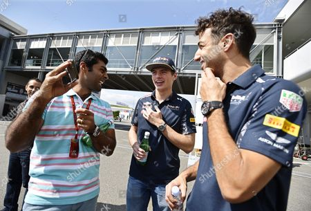 Stock Image of (l-r) Former Indian Formula One Driver Karun Chandhok Dutch Driver Max Verstappen of Red Bull Racing and His Australian Teammate Daniel Ricciardo Chat in the Paddock Ahead of the Japanese Formula One Grand Prix at the Suzuka Circuit in Suzuka Central Japan 06 October 2016 the 2016 Japanese Formula One Grand Prix Will Take Place on 09 October Japan Suzuka
