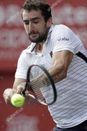 Marin Cilic of Croatia Hits a Return to Juan Monaco of Argentina During Their Men's Singles Quarterfinal Match at the Japan Open Tennis Championships in Tokyo Japan 07 October 2016 Japan Tokyo