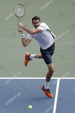 Stock Photo of Marin Cilic of Croatia Hits a Return to Juan Monaco of Argentina During Their Men's Singles Quarterfinal Match at the Japan Open Tennis Championships in Tokyo Japan 07 October 2016 Japan Tokyo