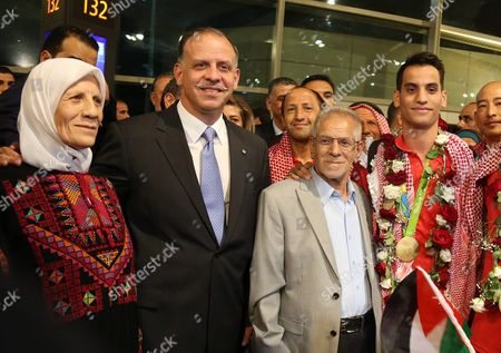 Jordanian Prince Faisal Bin Al Hussein President of the Jordanian Olympic Committee (2-l) Poses with Jordanian Taekwondo Olympic Winner Ahmad Abu Ghosh (r) who Won Jordan's First-ever Olympic Gold Medal Next to His Father (2-r) and His Mother (l) During His Arrival at Amman Airport Jordan Late 23 August 2016 the Jordanian 20-year-old Student Defeated Russia's Alexey Denisenko in a Brilliantly Fight 68-kg Division Gold Medal Match Abu Ghosh Beat Denisenko 10-6 Ghosh Also Knocked out South Korean Dae-hoon Lee Before Beating Olympic Champion Joel Bonilla Gonzalez of Spain Jordan Amman