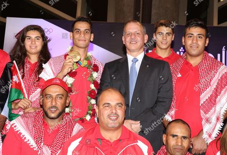 Jordanian Prince Faisal Bin Al Hussein President of the Jordanian Olympic Committee (c Back) Poses with Jordanian Taekwondo Olympic Winner Ahmad Abu Ghosh (c-l Back) who Won Jordan's First-ever Olympic Gold Medal During His Arrival at Amman Airport Jordan Late 23 August 2016 the Jordanian 20-year-old Student Defeated Russia's Alexey Denisenko in a Brilliantly Fight 68-kg Division Gold Medal Match Abu Ghosh Beat Denisenko 10-6 Ghosh Also Knocked out South Korean Dae-hoon Lee Before Beating Olympic Champion Joel Bonilla Gonzalez of Spain Jordan Amman