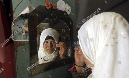 A Palestinian Women From Khirbet Susiya Community Applies Her Makeup in Front of the Mirror in Her Her Tent Near Hebron West Bank 20 July 2015 Palestinian News Agency of Mann Report the Israeli Civil Administration Had Informed the Populations Through Their Lawyers That It Will Demolish Some of the Facilities of the Community After the Muslim Feast of Eid Al-fitr the Israeli Supreme Court Decided on 04 May 2015 to Deport the 450 Inhabitants of Khirbet Susiya Under the Pretext of the Lack of Infrastructure For the Region - Khirbet Susiya