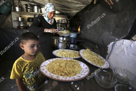 A Palestinian Women From Khirbet Susiya Community Making the Family Lunch in Her Tent Near Hebron West Bank 20 July 2015 Palestinian News Agency of Mann Report the Israeli Civil Administration Had Informed the Populations Through Their Lawyers That It Will Demolish Some of the Facilities of the Community After the Muslim Feast of Eid Al-fitr the Israeli Supreme Court Decided on 04 May 2015 to Deport the 450 Inhabitants of Khirbet Susiya Under the Pretext of the Lack of Infrastructure For the Region - Khirbet Susiya
