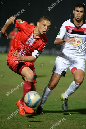 Fath Union Sport's Abdessalam Benjelloun (l) and Etoile Sportive Du Sahel's Rami Bedoui (r) Vie For the Ball During the Caf Confederation Cup Soccer Match Between Fath Union Sport of Morocco and Etoile Sportive Du Sahel of Tunisia at the Moulay El Hassan Stadium in Rabat Morocco 23 August 2016 Morocco Rabat