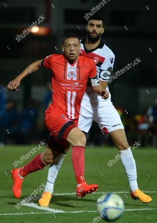 Fath Union Sport's Abdessalam Benjelloun (l) and Etoile Sportive Du Sahel's Hamdi Nagguez (r) Vie For the Ball During the Caf Confederation Cup Soccer Match Between Fath Union Sport of Morocco and Etoile Sportive Du Sahel of Tunisia at the Moulay El Hassan Stadium in Rabat Morocco 23 August 2016 Morocco Rabat