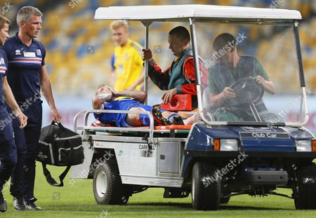 Ari Freyr Skulason (c) of Iceland is Taken From the Pitch After Being Injured During the Fifa World Cup 2018 Qualifying Soccer Match Between Ukraine and Iceland at the Olimpiyskyi Stadium in Kiev Ukraine 05 September 2016 Ukraine Kiev