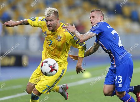Andriy Yarmolenko (l) of Ukraine in Action Against Ari Freyr Skulason (r) of Iceland During the Fifa World Cup 2018 Qualifying Soccer Match Between Ukraine and Iceland at the Olimpiyskyi Stadium in Kiev Ukraine 05 September 2016 Ukraine Kiev
