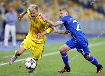 Stock Photo of Andriy Yarmolenko (l) of Ukraine in Action Against Ari Freyr Skulason (r) of Iceland During the Fifa World Cup 2018 Qualifying Soccer Match Between Ukraine and Iceland at the Olimpiyskyi Stadium in Kiev Ukraine 05 September 2016 Ukraine Kiev