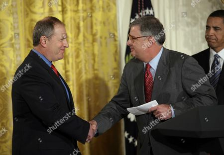 Stock Picture of Sam Palmisano, Chairman and CEO of IBM  (R) and David M. Cote, Chairman and CEO, Honeywell (L)