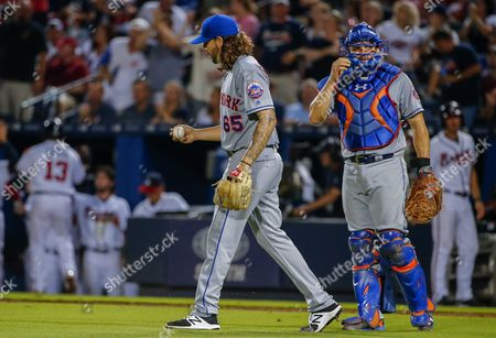 New York Mets Starting Pitcher Robert Gsellman (l) and Mets Catcher Travis D'arnaud (r) React in the Fifth Inning of the Mlb Baseball Game Between the New York Mets and the Atlanta Braves at Turner Field in Atlanta Georgia Usa 09 September 2016 United States Atlanta