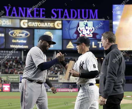 Boston Red Sox Designated Hitter David Ortiz (l) Greets New York Yankees Center Fielder Jacoby Ellsbury (c) and Former New York Yankees Pitcher David Cone (r) As They Present Him with a Leather Bound Book Before the Mlb Baseball Between the Boston Red Sox and the New York Yankees at Yankee Stadium in the Bronx New York New York Usa 29 September 2016 the Boston Red Sox Future Hall of Famer is Due to Retire at the Conclusion of the 2016 Season After 20 Seasons in the Major Leagues United States Bronx