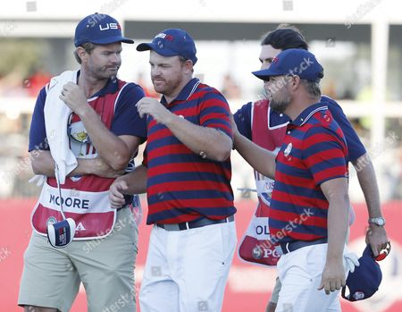 J B Holmes (2l) Snd Ryan Moore of the Us (r) Win Their Match on the Seventeenth Hole in the Afternoon Four-ball Matches During the Ryder Cup 2016 at the Hazeltine National Golf Club in Chaska Minnesota Usa 01 October 2016 the Ryder Cup 2016 Runs From 29 September to 02 October United States Chaska