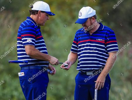 Team Usa's Phil Mickelson (l) and Team Usa's J B Holmes (r) Compare Putters During Practice For the Ryder Cup 2016 at the Hazeltine National Golf Club in Chaska Minnesota Usa 29 September 2016 the Ryder Cup 2016 Runs From 29 September to 02 October United States Chaska