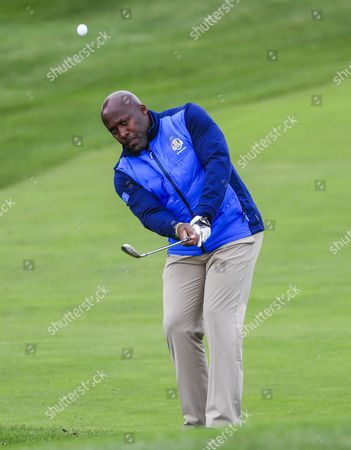 Stock Photo of Former British Athlete John Regis Chips Onto the First Green in the Celebrity Matches of the Ryder Cup 2016 at the Hazeltine National Golf Club in Chaska Minnesota Usa 27 September 2016 the Ryder Cup 2016 Runs From 29 September to 02 October United States Chaska