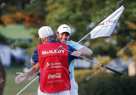 Rory Mcilroy (r) of Northern Ireland Hugs His Caddie J P Fitzgerald (l) on the Sixteenth Green After Mcilroy Won the Tour Championship Golf Tournament on the Fourth Playoff Hole and Earned the Fedex Cup at the East Lake Golf Club in Atlanta Georgia Usa 25 September 2016 the Tournament is the Finale of the Fedex Cup Playoffs United States Atlanta