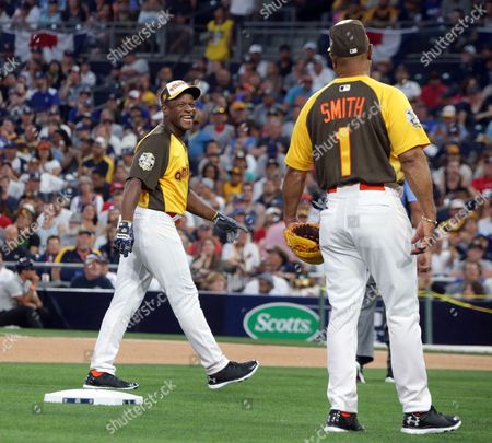 Former Major League Baseball Players Rickey Henderson (l) and Ozzie Smith (r) Share a Laugh During the All-star Celebrity Baseball Game at Petco Park in San Diego California Usa 10 July 2016 United States San Diego