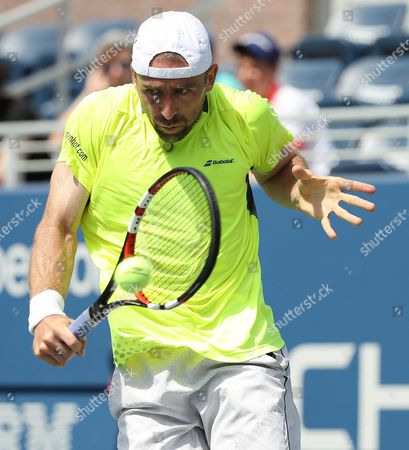 Benjamin Becker of Germany Hits a Return to Kei Nishikori of Japan on the Second Day of the Us Open Tennis Championships at the Usta National Tennis Center in Flushing Meadows New York Usa 30 August 2016 the Us Open Runs Through September 11 United States Flushing Meadows